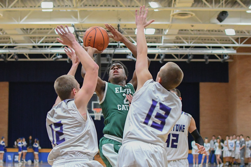 Eric Bonzar—The Morning Journal<br /> Elyria Catholic's Doug Taylor Jr. (22) shoots over the Keystone defense of Kevin Mealwitz (12) and Matt Mealwitz (13).
