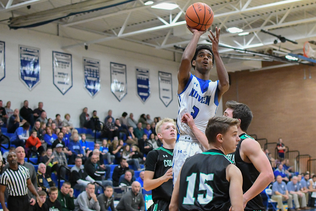 . Eric Bonzar�The Morning Journal Midview\'s Keith Johnson (2) shoots over the Columbia defense.