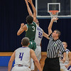 Eric Bonzar—The Morning Journal<br /> Keystone's Jeremy Gerhardinger (50) and Elyria Catholic's Dorian Crutcher (3) tip off the first game of the 17th annual Bob DiFranco Memorial Tournament, Dec. 2, 2016.