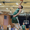 Eric Bonzar—The Morning Journal<br /> Elyria Catholic junior Dorian Crutcher rears back as he dunks on a fast break in the second half of the Panthers' game against the Keystone Wildcats, Dec. 2, 2016. The Panthers advanced to the championship game of the Bob DiFranco Memorial Tournament with a 61-50 win over the Wildcats.