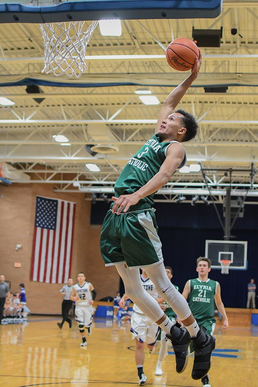 . Eric Bonzar�The Morning Journal Elyria Catholic junior Dorian Crutcher rears back as he dunks on a fast break in the second half of the Panthers\' game against the Keystone Wildcats, Dec. 2, 2016. The Panthers advanced to the championship game of the Bob DiFranco Memorial Tournament with a 61-50 win over the Wildcats.