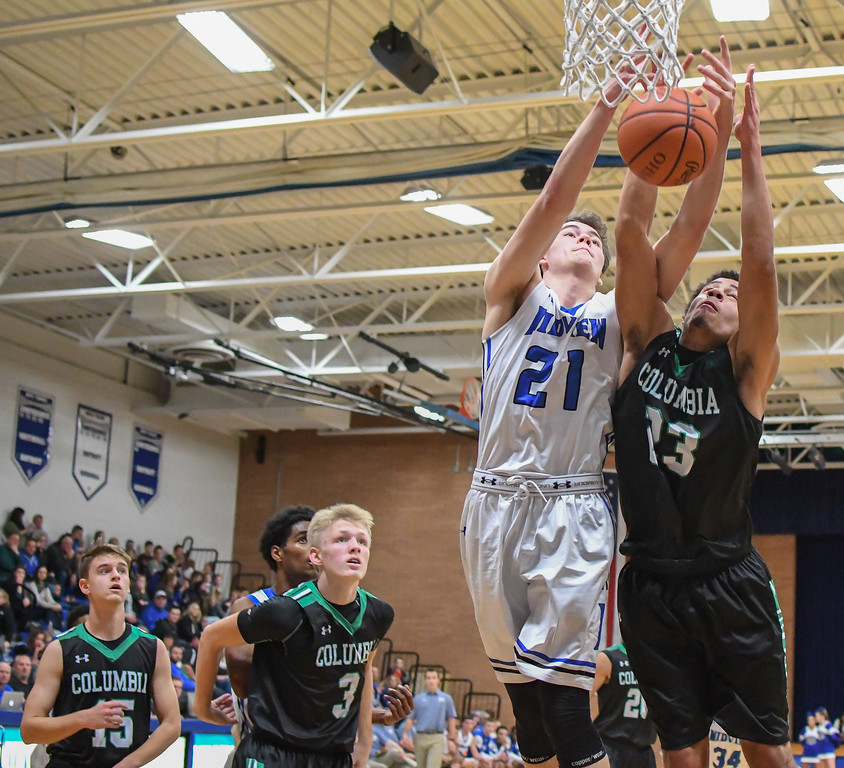 . Eric Bonzar�The Morning Journal Columbia\'s Brandon Coleman (23) and Midview\'s Gage Carnes (21) battle for a rebound.