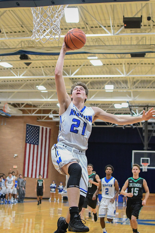 . Eric Bonzar�The Morning Journal Midview forward Gage Carnes (21) lays it in for two points on the fast break, Dec. 2, 2016. The Middies beat the Columbia Raiders 56-47 to advance to the championship game of the Bob DiFranco Memorial Tournament, against the Elyria Catholic Panthers.