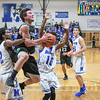 Eric Bonzar—The Morning Journal<br /> Columbia's Austin Sahlica (1) is fouled on his way to the rim by Midview's Keith Johnson (2).