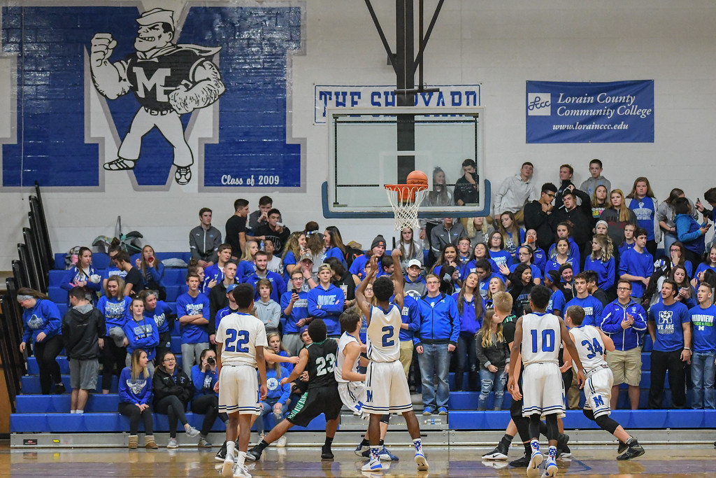 . Eric Bonzar�The Morning Journal Midview\'s  Keith Johnson (2) rattles around a foul shot.
