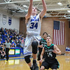 Eric Bonzar—The Morning Journal<br /> Midview's Derek Rebman (34) soars to the rim for an easy layup.