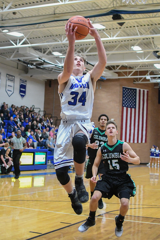 . Eric Bonzar�The Morning Journal Midview\'s Derek Rebman (34) soars to the rim for an easy layup.