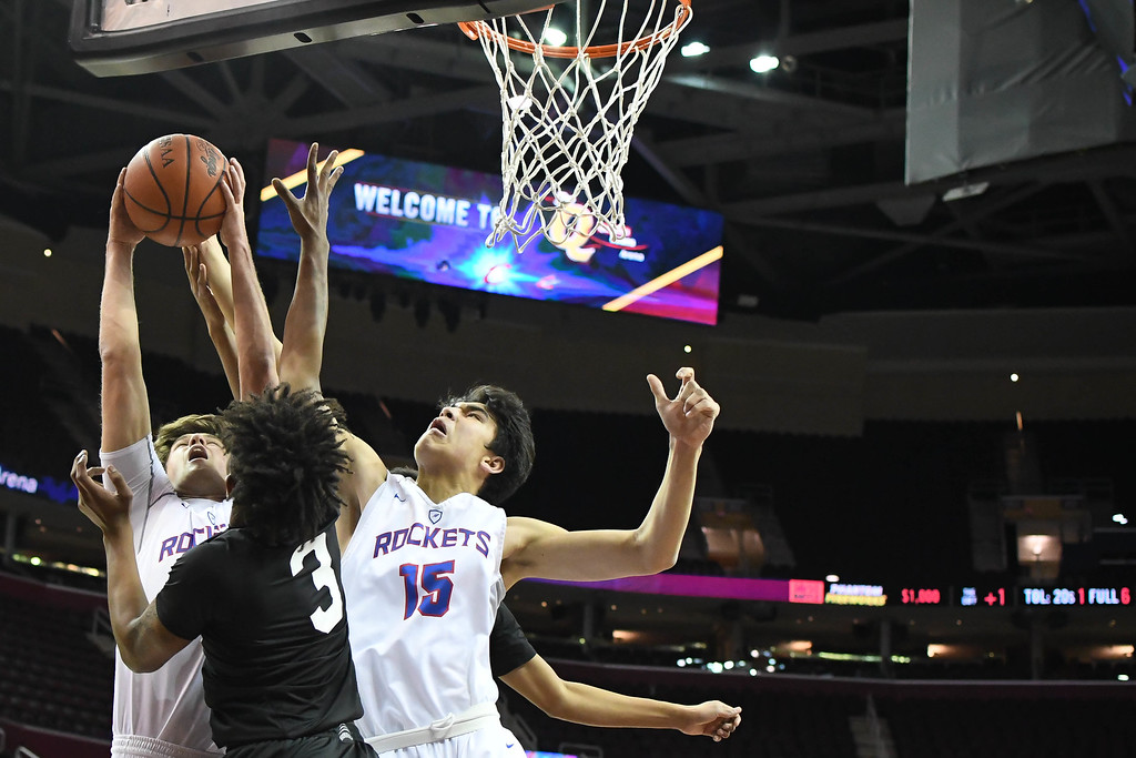 . Eric Bonzar�The Morning Journal Bay\'s Nick Cady (32) and RJ Sunahara (15) peel a rebound away from Northstar Christian\'s Bryan Clemetson (3).