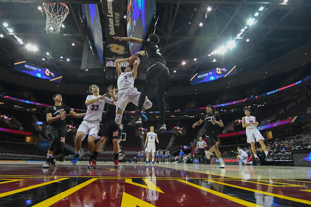 . Eric Bonzar�The Morning Journal Bay guard Max Showalter (3) soars to the hoop.