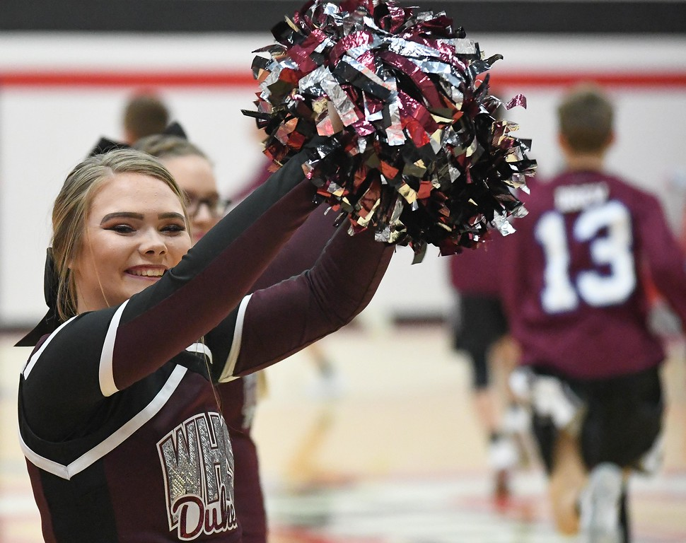 . Eric Bonzar�The Morning Journal<br> A Wellington Dukes Cheerleader cheers on her team as they make their way onto the court of the Brookside Cardinals, Dec.  22, 2017.