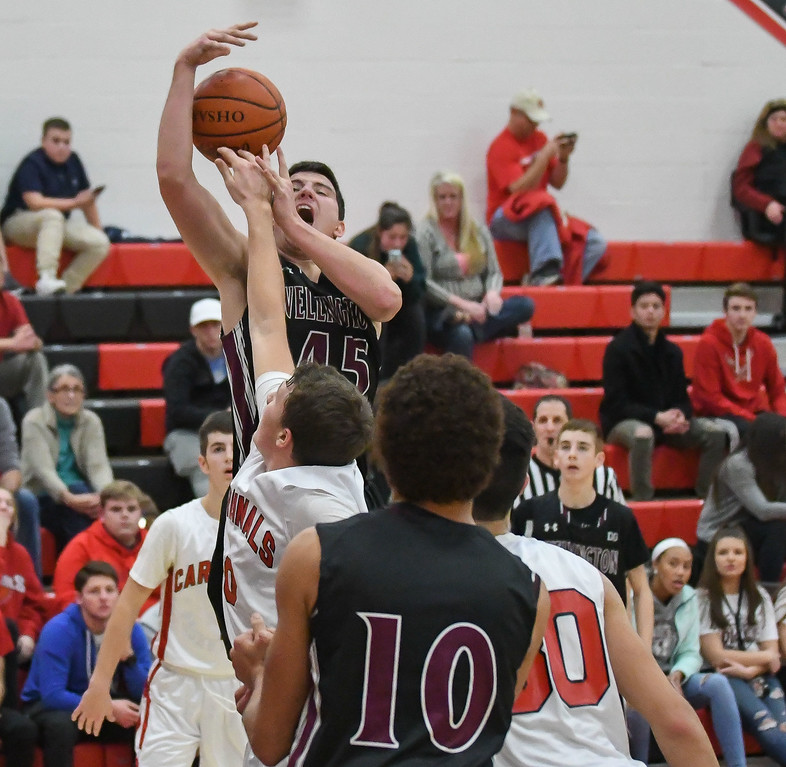 . Eric Bonzar�The Morning Journal<br> Wellington forward Maxwell Joppeck (45) elevates over Brookside\'s Cody Mortensen for the offensive rebound.