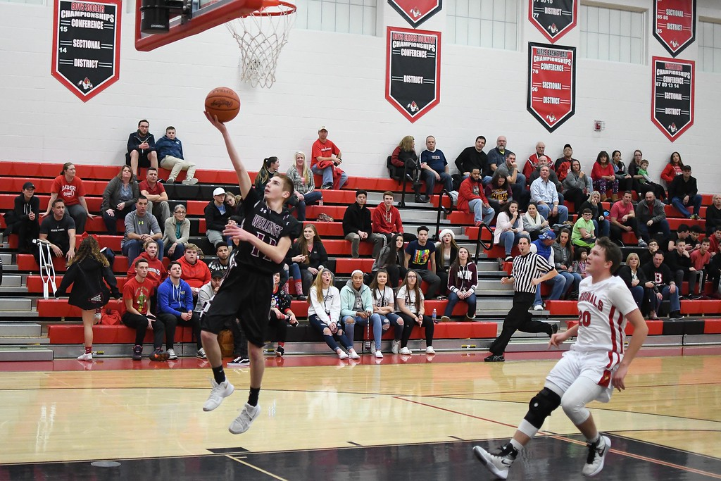 . Eric Bonzar�The Morning Journal<br> Wellington\'s Brandon Orozco hits a layup off of a fastbreak.