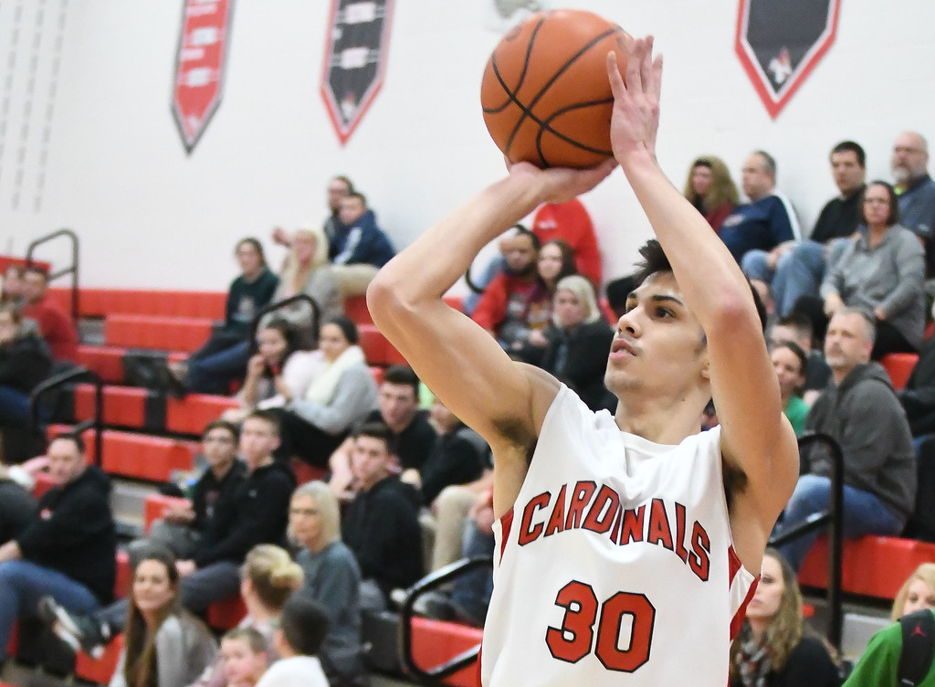 . Eric Bonzar�The Morning Journal<br> Brookside guard Jacob Cole sinks a three-point basket.
