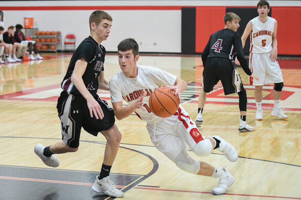. Eric Bonzar�The Morning Journal<br> Brookside\'s Dylan Smith cuts through the key past Wellington guard Brandon Orozco.