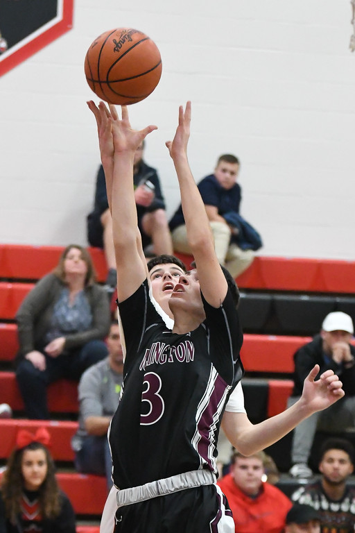 . Eric Bonzar�The Morning Journal<br> Wellington \'s Noah Diermyer fights for a rebound under the basket.