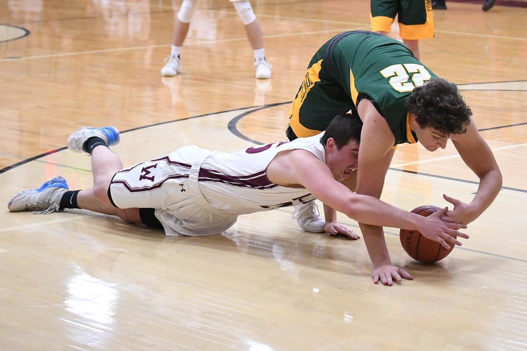 . Eric Bonzar�The Morning Journal<br> Wellington forward Maxwell Joppeck and Amherst\'s Matt Fairchild (22) go to the ground for a loose ball.