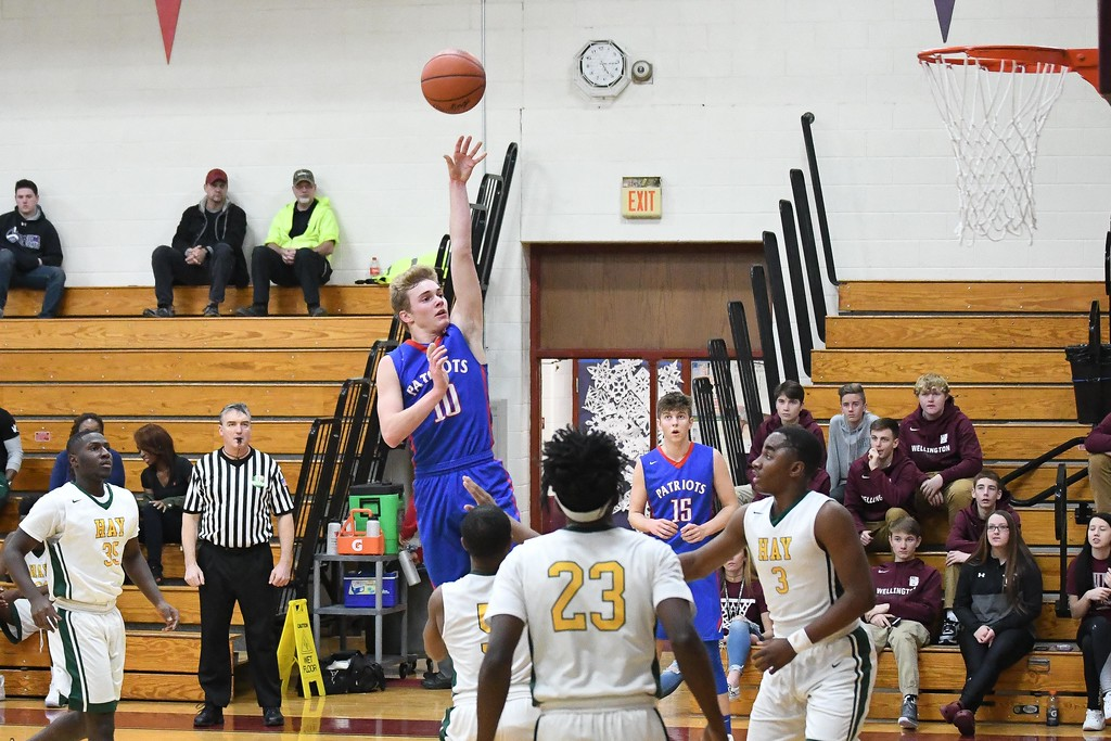 . Eric Bonzar�The Morning Journal<br> Open Door\'s Carter Wright (10) tosses up a floater over the John Hay defenders.