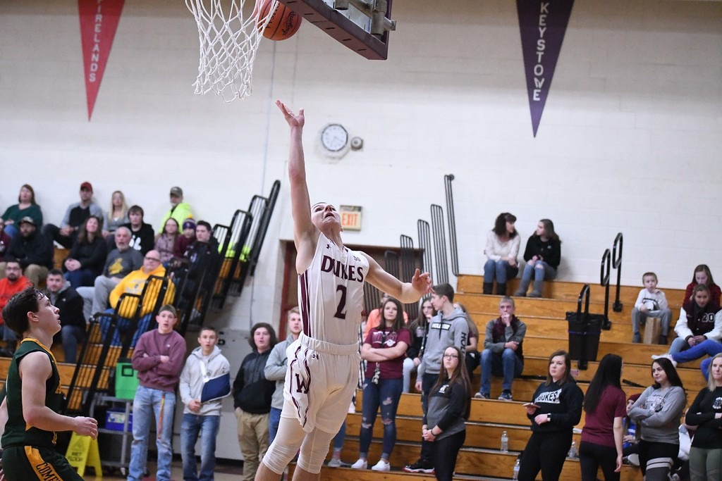 . Eric Bonzar�The Morning Journal<br> Wellington guard Ryan Whitaker lays it in for an uncontested basket.