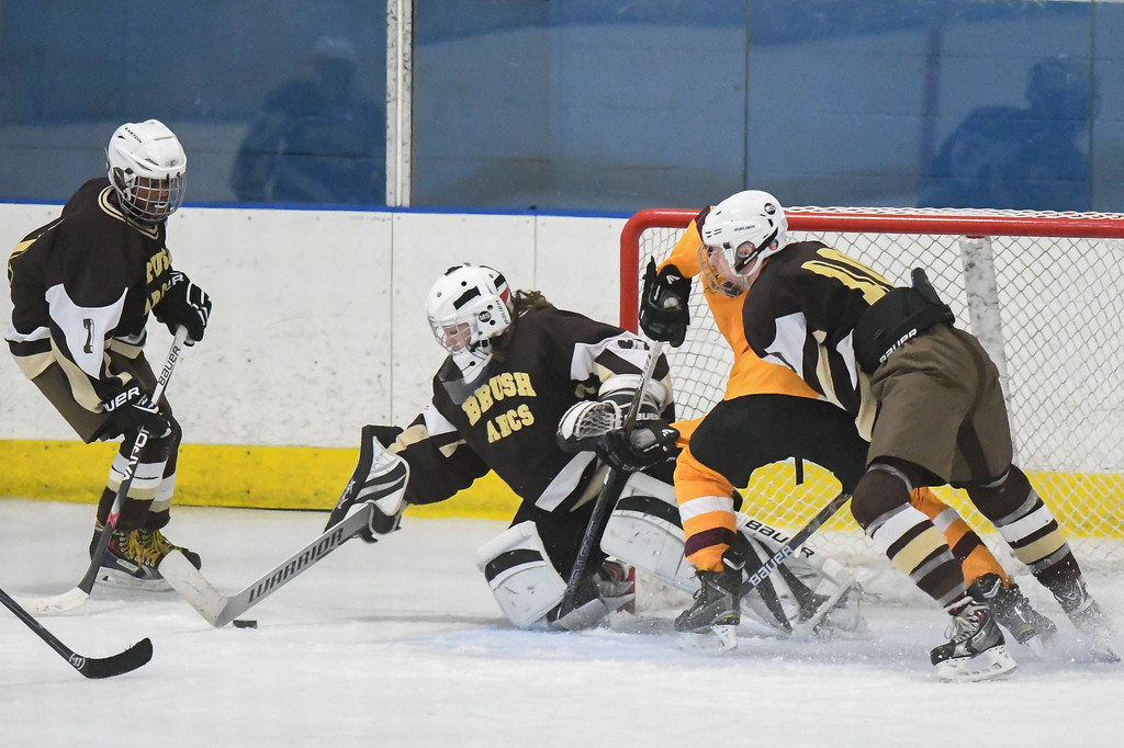 . Eric Bonzar�The Morning Journal Brush goalie Mike Kornet (31) dives to clear the puck from the goal.