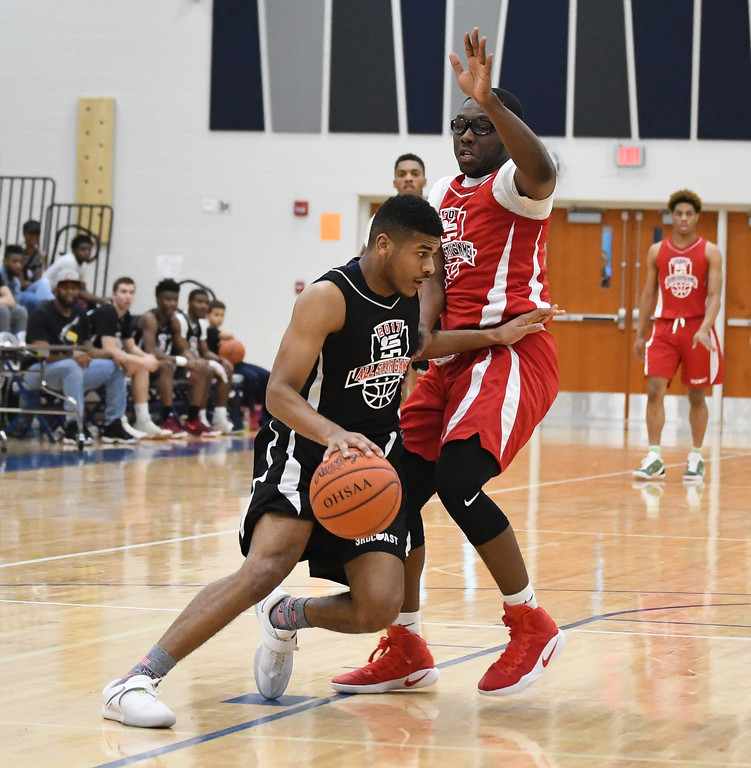 . Eric Bonzar�The Morning Journal Lorain\'s Jalil Little drives around Elyria\'s Antonio Blanton during the 3rd Coast Hoops All-Star game, April 15, 2017.