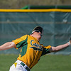 Eric Bonzar—The Morning Journal<br /> Amherst's Michael Burgess can't turn on a fly ball in time.