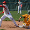 Eric Bonzar—The Morning Journal<br /> Amherst's Evan Shawver slides under the tag of Mentor shortstop Nick Smith.