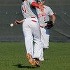 Eric Bonzar—The Morning Journal<br /> A pop fly falls between shortstop Nick Smith (11) and outfielder Jeremy McClure.