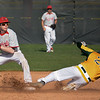 Eric Bonzar—The Morning Journal<br /> Amherst's Carter Zajkowski slides into a force out as Mentor second baseman Tommy Klepcyk steps on the bag in the bottom of the fifth inning.