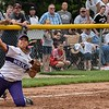 Eric Bonzar—The Morning Journal<br /> Keystone's Sammie Stefan throws, from her knees, to first base for the out.