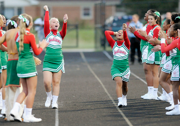 Don Knight   The Herald Bulletin<br /> Anderson's cheer leaders lead a cheer as the Indians opened their football season at home against Ft. Wayne Wayne on Friday.