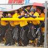 The Shenandoah dugout tries to stay dry during a light rain as the Anderson Indians hosted the Raiders on Wednesday.
