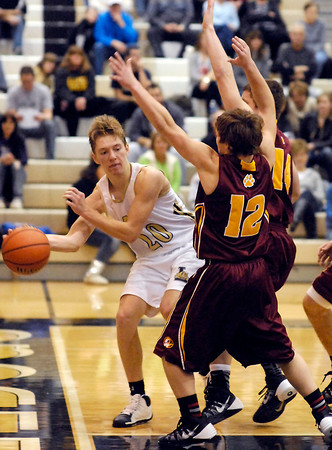 Lapel's Bailey Partington looks to pass the ball as he is being forced out of bounds by Lapel's Bryce Montgomery.
