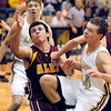 Alexandria's Jake Thurston loses the ball as he collides with Lapel's Mitchell Richardson while driving to the basket.