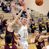 Lapel's Mitchell Richardson, #14, gets the ball knocked out of his hands by Alexandria's Jonah Jerrils as he drives into the lane.