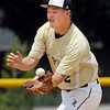 Lapel infielder Dane Mason can't get the handle on a ground ball to commit one of the five errors against the Bulldogs.