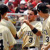 Boston Fields of Lapel is greeted by teammates after scoring to start a seventh inning rally that fell a run short.