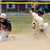 Boston Fields of Lapel slides into second with a stolen base as Wapahanis' Hayden Woodard gathers in the throw.