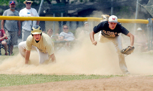 Lapels' Dane Mason slides into third taking out the third baseman Tyler Replogle during a seventh inning rally that fell one run short.