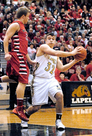 Lapel's Brady Cherry fakes his defender, Wes Royse of Wapahani, off his feet as he drove into the lane.
