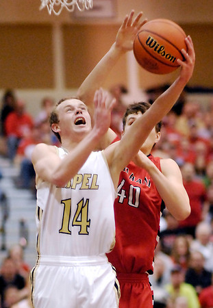 Lapel's Mitchell Richardson goes up for a shot as Jacob Foster of Wapahani tries to deflect the ball from behind.