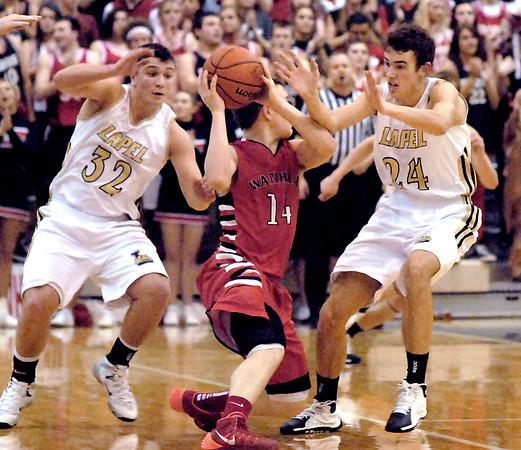 Lapel's Brady Cherry and Noah Herdershot double up on defense aganist Tanner Davis of Wapahani.