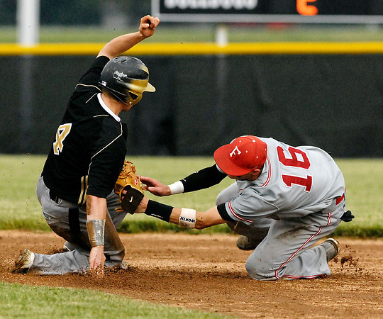 Lapel's Cole O'Connor slides around the tag of Frankton's second baseman Trevor Hughes to steal second in the 6th inning of the game.