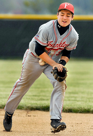 Frankton's second baseman Bryce Mallernee miss-plays a grounder as it bounces off his body and he couldn't make a play on the runner.