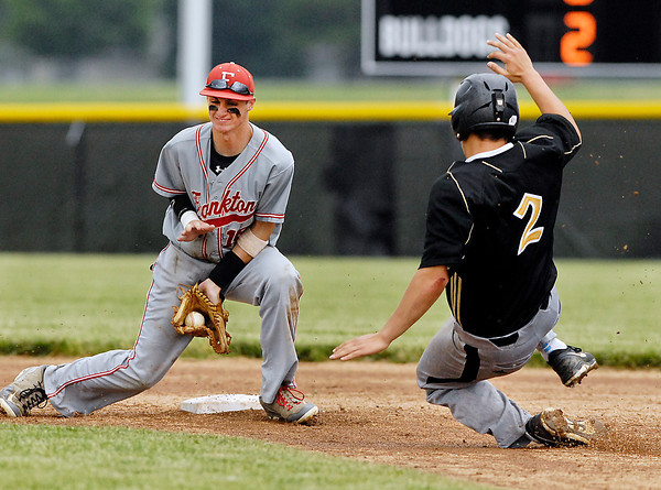Frankton's 2nd baseman Trevor Hughes catches the ball in his glove as Lapel's Dane Mason starts his slide into second base on a steal attempt in the 5th inning of their sectional championship game.  Mason was tagged out on the play.