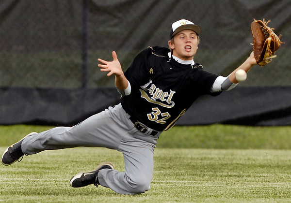 Lapel's Devon Dowden dives for this fly ball that just dropped in front of him for a hit.
