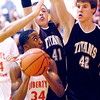 THB photo/John P. Cleary<br /> Liberty Christian's Franklin Nunn tries to make a move up to the basket as Tri's Zach Poling and Lucas Williams put on the defensive pressure.