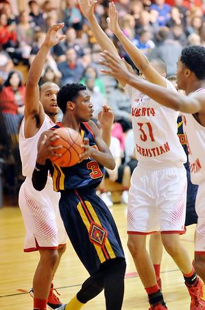John P. Cleary | The Herald Bulletin<br /> The Liberty Christian Lions plays Seton Catholic Cardinals in boys basketball.