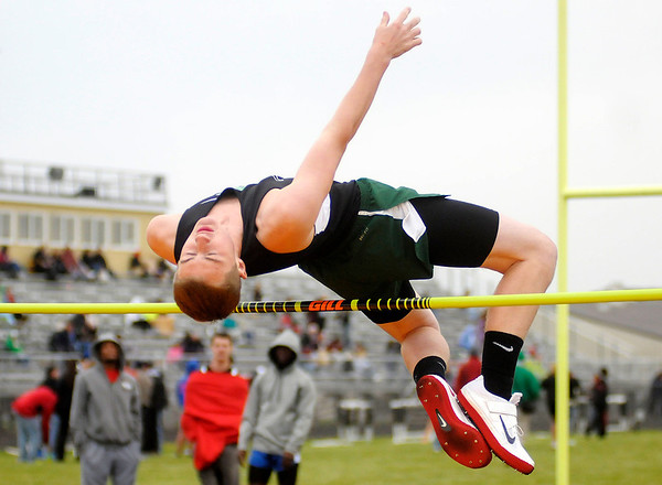 Pendleton Heights' T.J. Hicks clears 5 feet, 10 inches during the high jump competition at the Madison County Track and Field Championships at Madison-Grant on Friday.