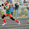 Anderson's Derrick Dabney wins the 100-meter dash during the Madison County Track and Field Championships at Madison-Grant on Friday.