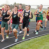 Pendleton Heights' Sam Bayliss, left, and Brandon Smith lead the pack at the start of the 1600 meter run during the County Championship Track Meet at Madison-Grant on Friday. Smith went on to finish first followed by Bayliss.
